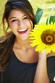 stock photo of summer fun  - Young attractive happy girl enjoys summer day - JPG