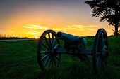 An American Civil War Cannon Sits In A Pennsylvania Field Behind A Wall. poster