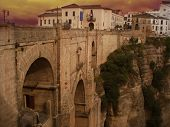 image of parador  - Ancient Bridge in Spanish town Ronda at sunset - JPG