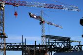stock photo of construction crane  - construction site including steel structure and crane - JPG