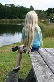 picture of pubescent  - young blond girl sitting at lake - JPG