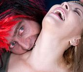 foto of drakula  - The horror concept with a vampire biting young beautiful woman  - JPG
