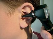 image of otoscope  - image of dctor examaning a child - JPG