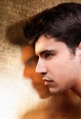 stock photo of close-up shot  - Close up  handsome man with gold shadow - JPG