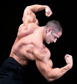 stock photo of body builder  - Back view of a body builder - JPG