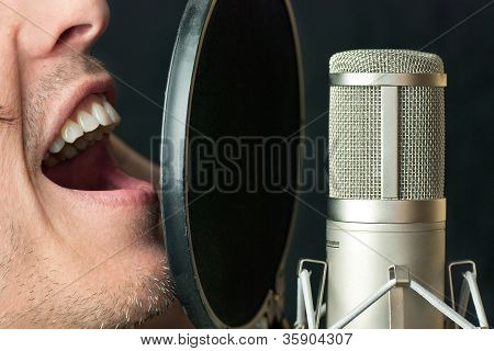 Man Sings Into Condenser Microphone, Close