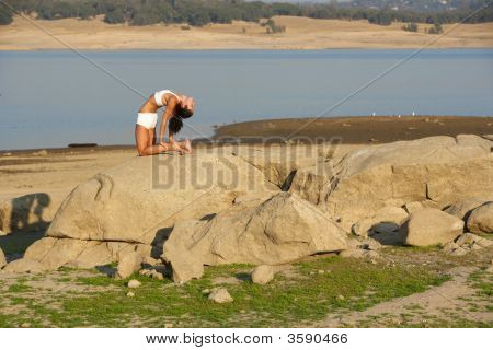 A Young Woman Doing Yoga At Sunset