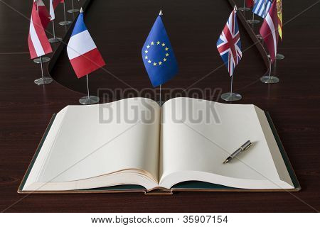 Open spread book, fountain pen, EU (European Union) flag