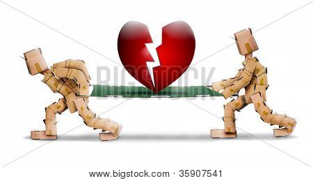 Broken heart carried on a stretcher by box men