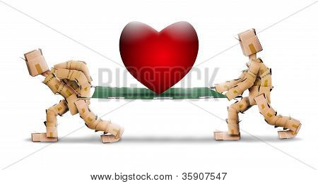 Big love heart on stretcher carried by box men