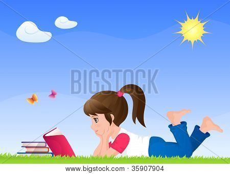 cute small girl reading a book on a sunny meadow