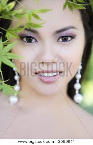 Pretty Young Asian Woman In The Park