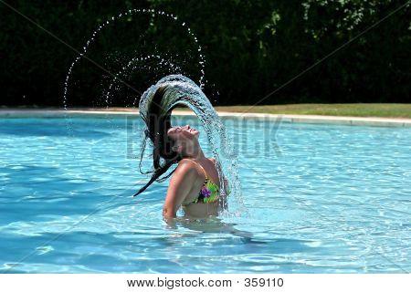 Girl Or Woman In Swimming Pool Throwing Wet Hair Back