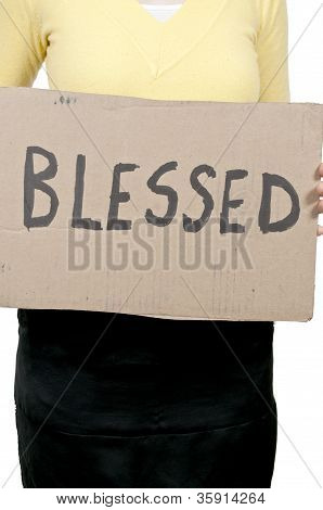 Woman Holding Sign That Says Blessed