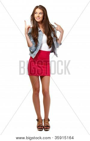 Nice Brunette Young Woman Pointing At Copyspace