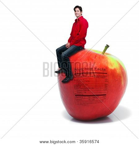 Man Sitting On An Apple With Nutrition Label