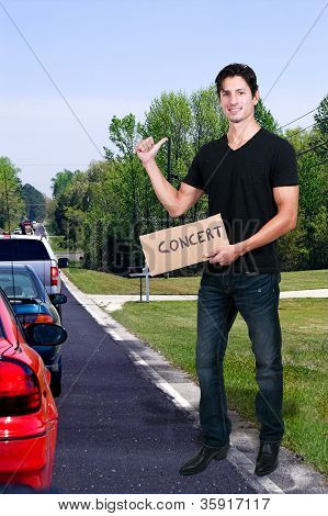 Man Hitch Hiking To A Concert
