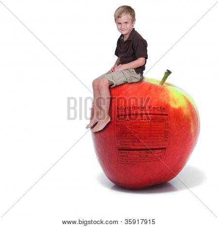 Little Boy Sitting On An Apple With Nutrition Label