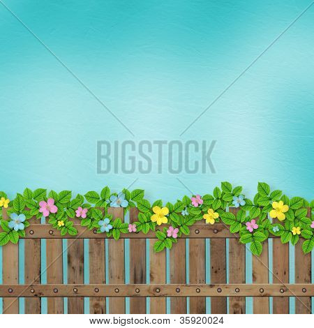 Wooden Fence With A Flower Garland On The Abstract Background Of A Summer Day