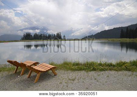 Chairs near a mountain lake