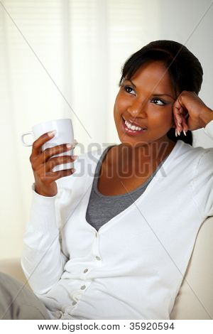 Charming Young Woman Holding A White Mug