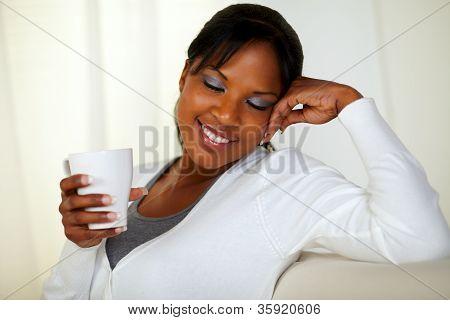 Afro-american Woman Holding A White Mug