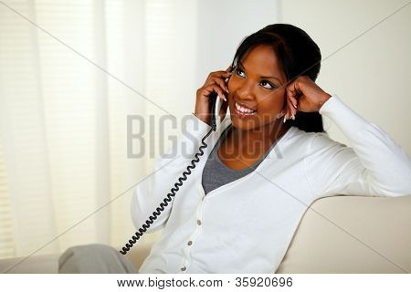 Smiling Young Woman Talking On Phone