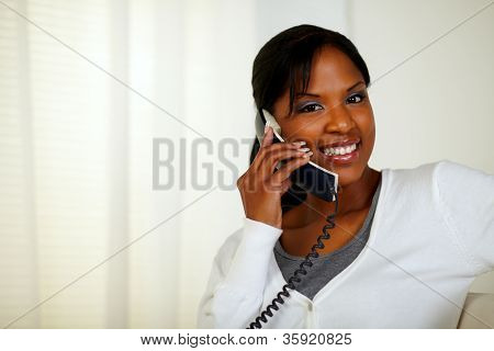 Smiling Black Woman Looking At You While Talking