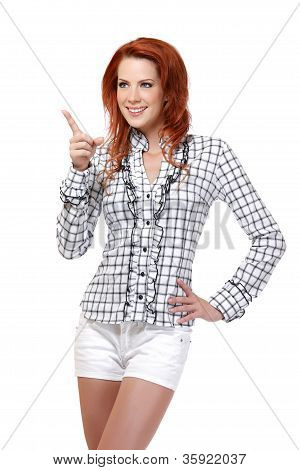 Portrait Of A Happy Redhead Woman Pointing At Copyspace