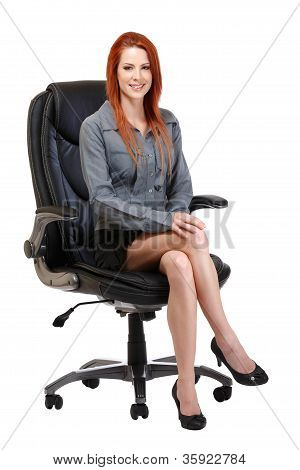 Happy Redhead Woman Sitting On Chair