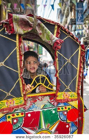 Portrait Of Boy In Rickshaw