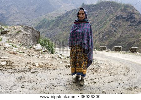 Tibetan Woman Poses For The Photo In Himalaya Mountains