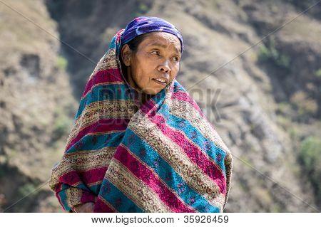 Portrait Of Tibetan Woman In Himalaya Mountains