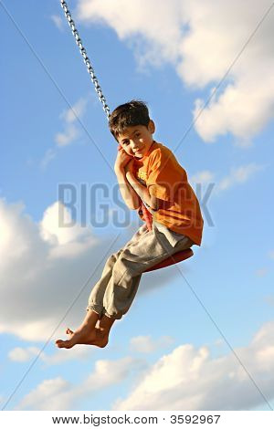 Young Boy Excited Being On The Chain Swing