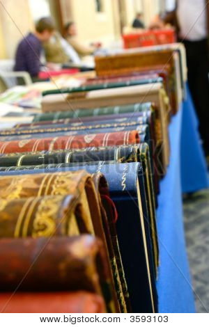 Rows Of Ancient Leather Bound Bible Books On Sale On Side Street