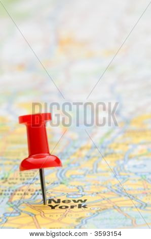 Red Pushpin Marking New York City On A Map