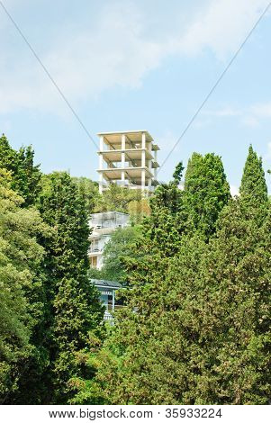 New Apartments Building Over  Blue Sky  And  Green  Tree.crimea. Ukraine.