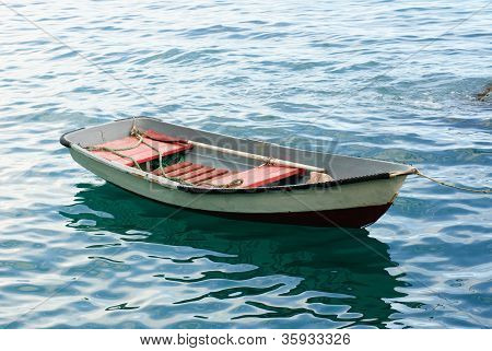 Lifeboat With Paddle. Old Wooden Boat