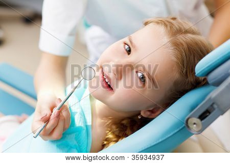 Little girl visiting dentist