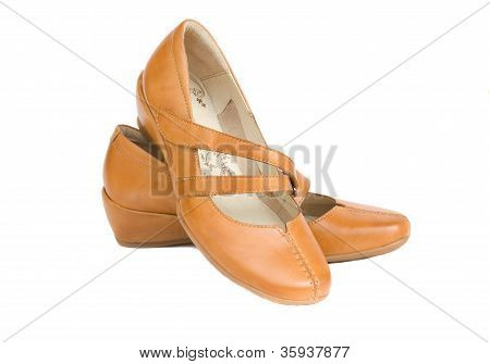 pair of woman leather nude  shoes