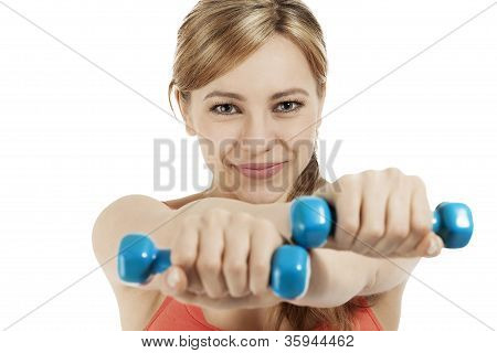 cute fitness woman exercising with blue dumbbells