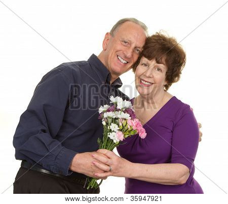 Elderly Couple With Flowers