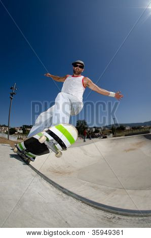 Skateboarder In A Concrete Pool