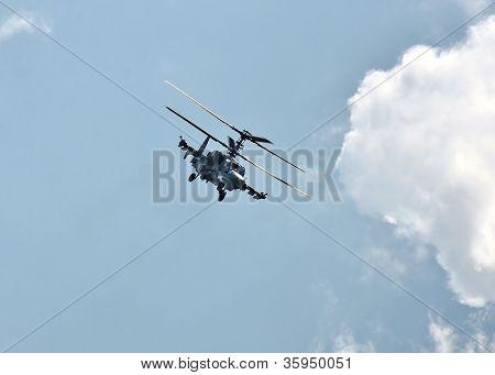 Combat Helicopter In Flight