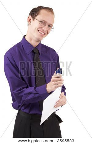Businessman Stapling The Papers