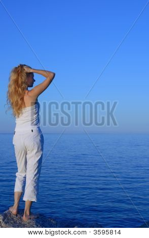 Beautiful Young Woman Looking At The Sea