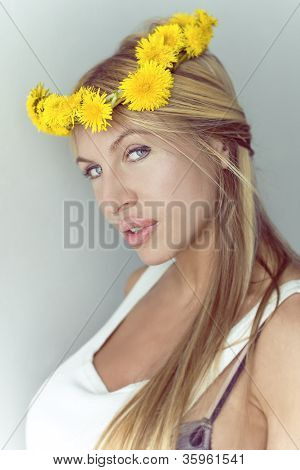 Beautiful Woman With A Wreath From Dandelions