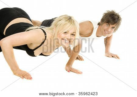 Man And Woman Working Out Isolated On A White Background