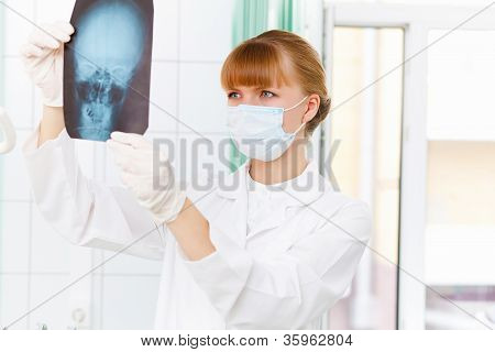 Female doctor with X-ray
