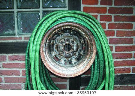 Garden hose on a rim